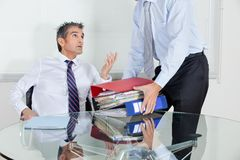 Businessmen Overwhelmed By Load Of Work Stock Image