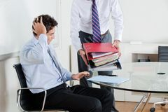 Businessmen Overwhelmed By Load Of Work Royalty Free Stock Photo