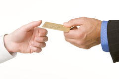 Businessmen Passing Another A Gold Credit Card Royalty Free Stock Photo