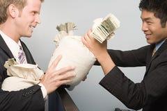 Businessmen passing money Royalty Free Stock Photos