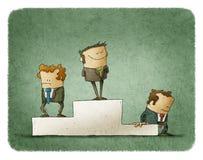 Businessmen on pedestal Royalty Free Stock Image