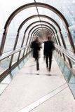 Businessmen on a pedestrian bridge Royalty Free Stock Photography