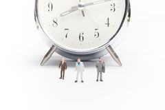 Businessmen people on clock Royalty Free Stock Photos