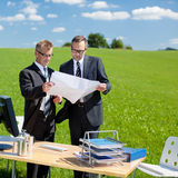 Businessmen planning something in nature Stock Photos