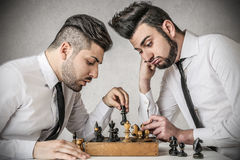 Businessmen playing chess Royalty Free Stock Images