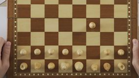 Businessmen playing chess game, business strategy, rivalry on business market