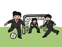 Businessmen playing football Stock Images