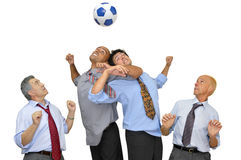 Businessmen playing soccer Stock Photography