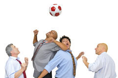 Businessmen playing soccer Stock Image