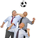 Businessmen playing soccer Royalty Free Stock Images