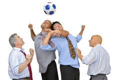 Businessmen playing soccer Royalty Free Stock Photos