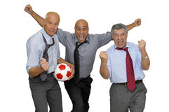 Businessmen playing soccer Stock Photo