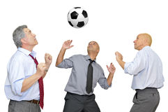Businessmen playing soccer Stock Images