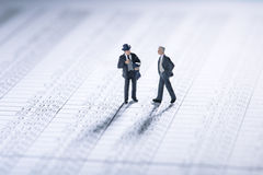 Businessmen playing the stock market Royalty Free Stock Photo