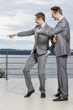 Businessmen pointing at something against sky Royalty Free Stock Photo
