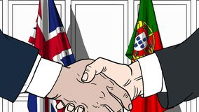 Businessmen or politicians shake hands against flags of Britain and Portugal. Official meeting or cooperation related. Businessmen shake hands against flags of stock illustration