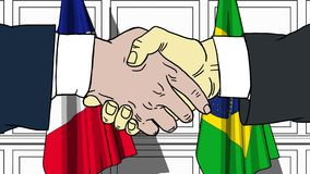 Businessmen or politicians shaking hands against flags of France and Brazil. Meeting or cooperation related cartoon. Businessmen or politicians shaking hands stock video footage