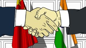 Businessmen or politicians shaking hands against flags of China and India. Meeting or cooperation related cartoon. Businessmen or politicians shaking hands stock footage
