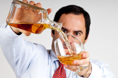Businessmen pouring  a glass of whiskey Stock Photography