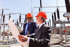 Businessmen power plant Stock Photography