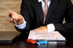 Businessmen present contract on trading - rent a car. Businessme royalty free stock images