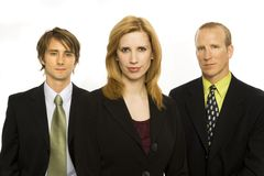 Businessmen with pride. Three business workers stand together Royalty Free Stock Photos