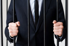 Businessmen in prison. Stock Photography