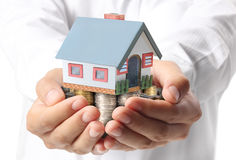 Protect Your House in hand Royalty Free Stock Photography