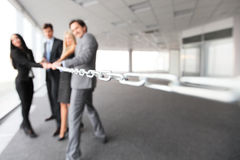 Businessmen pulling chain Royalty Free Stock Images