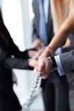 Businessmen pulling chain Royalty Free Stock Image