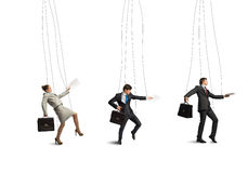 Businessmen puppets. Business people puppets hanging by a thread royalty free stock photo
