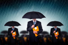 Businessmen in rain Royalty Free Stock Photography