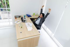 Businesssman are happy after working. Businessmen are raising their arms happily after work stock photo