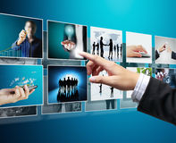 Businessmen and Reaching images streaming. Touch screen, reaching images streaming Royalty Free Stock Photos