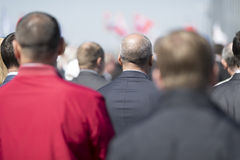 Businessmen. Real people on the street, selective focus royalty free stock photo