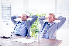 Businessmen relaxing at work Stock Images