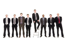Businessmen in a row Stock Images