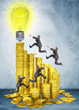 Businessmen run and jump on money stairs Stock Images