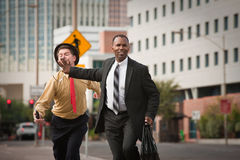 Businessmen In A Rush Stock Photography
