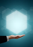 Businessmens hands. Hexagons floating on business men on green background stock image