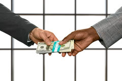 Businessmen's hands passing money bundle. Royalty Free Stock Photography