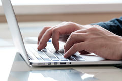 Businessmen's hands typing on laptop Royalty Free Stock Photos