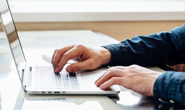 Businessmen's hands typing on laptop. Keybord for business or education tasks royalty free stock photos