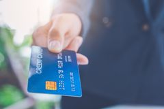 Free Businessmen Send Blue Credit Cards For Payment Of Goods Stock Photo - 154753870