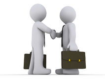 Businessmen shake hands Stock Photo