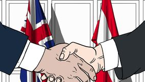 Businessmen or politicians shake hands against flags of Britain and Austria. Official meeting or cooperation related. Businessmen shake hands against flags of royalty free illustration