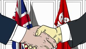 Businessmen or politicians shake hands against flags of Britain and Hong Kong. Official meeting or cooperation related. Businessmen shake hands against flags of royalty free illustration