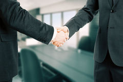 Businessmen shake hands in the conference room Royalty Free Stock Images
