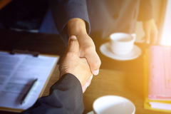 Businessmen shake hands with contract Royalty Free Stock Photo