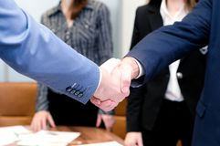Businessmen shake hands each other royalty free stock photography